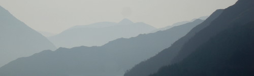 the Five Sisters mountain range in silhouette on a misty morning